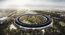 Le futur siège social d'Apple. Le gentil « donut » ressemble aussi au panoptique de Bentam où le surveillant au centre,  peut embrasser d'un seul coup d'oeil toutes les cellules.